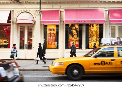 New York, New York, USA - March 27, 2011: The Victoria's Secret store on Broadway in the Soho area of downtown Manhattan. People are seen as a car and Taxi drive by in the late afternoon.