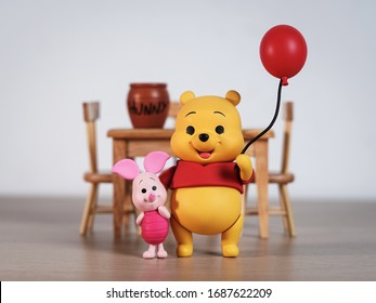 New York, USA - March 30, 2020: Winnie the Pooh and Piglet come out to greet everyone.