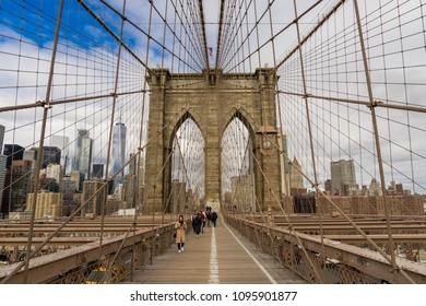 NEW YORK, USA - MARCH 5, 2018: View from the pedestrian walkway of Brooklyn Bridge in New York City. One of the oldest roadway bridges in USA.