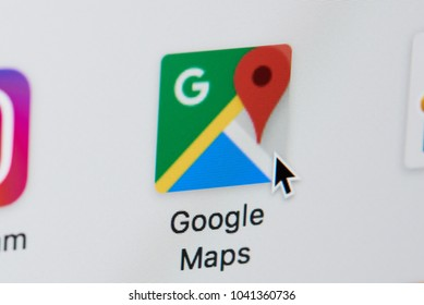 New york, USA - March 8, 2018: Opening google maps web page on laptop screen close-up. Cursor on computer icon