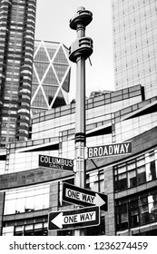 NEW YORK, USA - May 01, 2016: Black and white image of street signs for Broadway and Columbus Circle, Manhattan, NYC