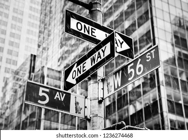 NEW YORK, USA - May 01, 2016: Rain in New York City. Street signs for Fifth avenue and W 56 st crossroad in New York City, Manhattan, USA