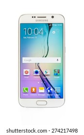"""New York, USA - May 01, 2015: Studio shot of a White Pearl Samsung Galaxy S6 smartphone. Samsung Galaxy S6 is supported with 5.1"""" touch screen display and 1440 x 2560 pixels resolution."""