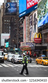 NEW YORK, USA - May 03, 2016: Police officer performing his duties on the streets of Manhattan. New York City Police Department (NYPD) is the largest municipal police force in the United States