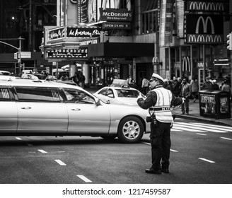 NEW YORK, USA - May 03, 2016: Black and white image of Police officer performing his duties on the streets of Manhattan. New York City Police Department (NYPD) is largest municipal police force in US