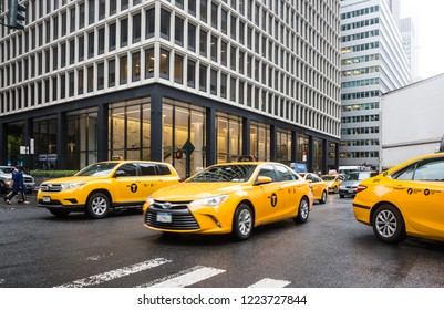 New York, USA - May 03, 2016: Yellow taxi on street of Manhattan in New York. City street scene with a yellow taxi cabs
