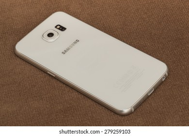 """New York, USA - May 03, 2015: Back view of White Pearl Samsung Galaxy S6 smartphone showing the camera. Samsung Galaxy S6 is supported with 5.1"""" touch screen display and 1440 x 2560 pixels resolution."""