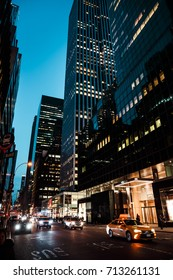 NEW YORK, USA - May 03, 2016: New York City streets at night. Lights and shadows of NYC. Lights of advertising on streets of Manhattan at night.