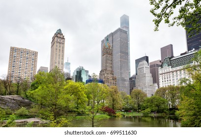 NEW YORK, USA - May 04, 2016: Central Park and Manhattan Skyline. Midtown Manhattan skyline view from Central Park on an overcast day. Pond at Central Park