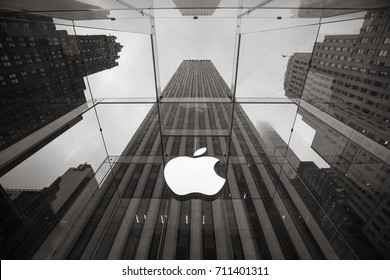 NEW YORK, USA - May 04, 2016: Apple Store logo at the entrance to the Apple Store on Fifth Avenue New York. Apple Store cube on 5th Avenue on a cloudy rainy day