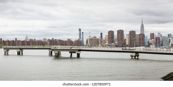 NEW YORK, USA - May 05, 2016: View of Midtown Manhattan skyline with Empire State Building from Brooklyn over the East River