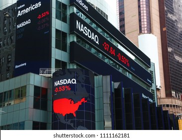 New York, USA - May 1, 2018: Nasdaq quotation on illuminated boards in Times Square