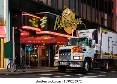 New York, USA – May 1, 2018: Horizontal night view of a truck parked in front of the USA Brooklyn Diner en Midtown Manhattan