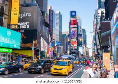 New York, USA - May 10, 2018: People and traffic at Times Square in New York City. It is a major commerical and entertainment center in Midtown Manhattan.
