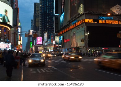 NEW YORK, USA, MAY 10th, 2013. Times Square urban night scene with taxis and cars passing by along 7th Avenue and advertising lights in New York City. Taken on May 10th, 2013.