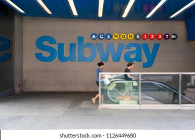 New York, USA - May 11, 2018: People entering a subway station in New York. The subway in New York is the largest in the world and also one of the oldest public transit systems.