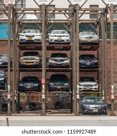 New York, USA - May 11, 2018: Vertical car park in Manhattan New York. It is designed to minimize the area quired for parking cars.
