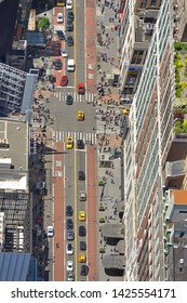 NEW YORK, USA - MAY 11, 2019: People and cars on West 34th Street in Manhattan. View from above