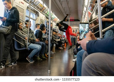 New York, USA - May 13, 2018: Man performing dance in a subway train in New York City.