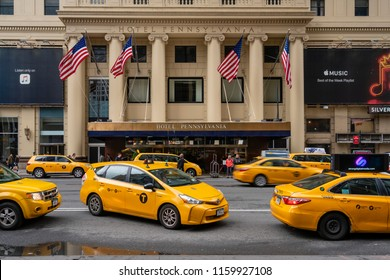 New York, USA - May 14, 2018: Taxis waiting outside Hotel Pennsylvania in New York City. It is the fourth largest hotel in the city.