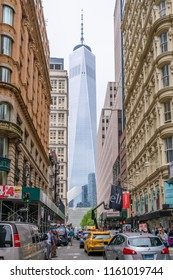 New York, USA - May 15, 2018: View of the One World Trade Center from Fulton Street. It is the main building of the rebuilt World Trade Center complex in Lower Manhattan.