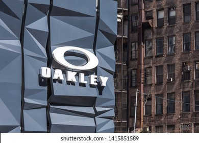 NEW YORK, USA - MAY 15, 2019: Oakley logo Sign on wall above store in Manhattan. Oakley designs, develops and manufactures sports performance equipment, lifestyle pieces