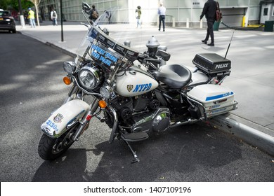New York / USA - May 18 2019: NYPD Motorcycle parked on the street