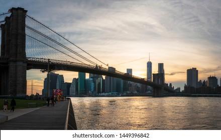 New York, USA - May 19 2015: Brooklyn Bridge, East River, Lower Manhattan skyline, New York skyline at sunset, New York City, United States of America, North America