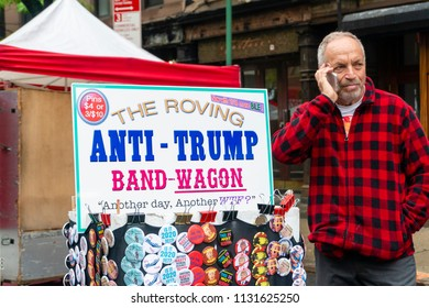 New York, USA - May 20, 2018: Anti-trump pins for sale at a stall in New York City. Protests against Donald Trump have occurred around USA, since his entry into the 2016 presidential campaign