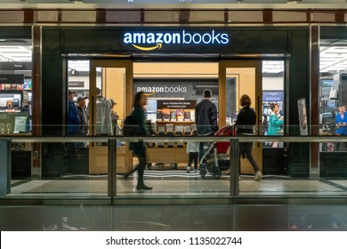New York, USA - May 20, 2018: People visiting the Amazon Books store in New York City. It is a chain of retail bookstores owned by the online retailer Amazon.