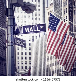 NEW YORK, USA - MAY 20, 2018: The historic architecture of Wall Street in New York city with its neoclassic building facades and monuments by the New York Stock Exchange.
