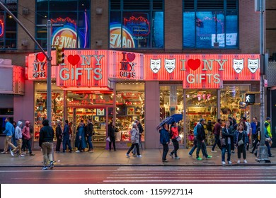 New York, USA - May 20, 2018: People outisde a gift shop near Times Square in New York City