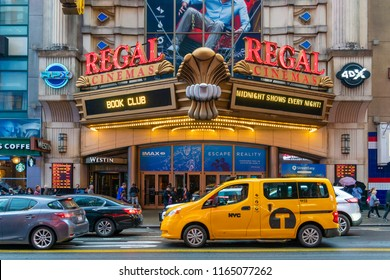 New York, USA - May 20, 2018: People visiting the Regal Cinema in New York City. It is a UK based cinema chain.