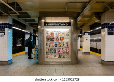 New York, USA - May 21, 2018: Man buying at a newsstand in a subway station in New York City.