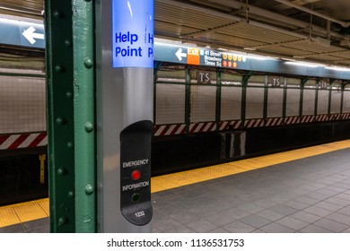 New York, USA - May 21, 2018: Emergency and information help point in a subway station in New York City