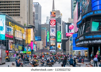 New York, USA - May 23, 2018: People at Times Square in New York City. It is a major commerical and entertainment center in Midtown Manhattan.