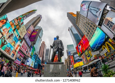 New York, USA - May 23, 2018: View of George M. Cohan statue at Times Square in New York City. It is a major commerical and entertainment center in Midtown Manhattan.