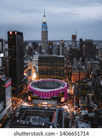New York / USA - May 23 2019: view from top on Madison Square Garden and Empire State Building. Night Lights
