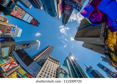 New York, USA - May 24, 2018: View of billboards and buildings at Times Square in New York. It is a major tourist attraction and entertainment center in the Midtown Manhattan of New York City.