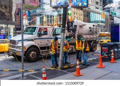 New York, USA - May 24, 2018: Workers cleaning sewer and performing maintence work at Midtown Manhattan in New York City