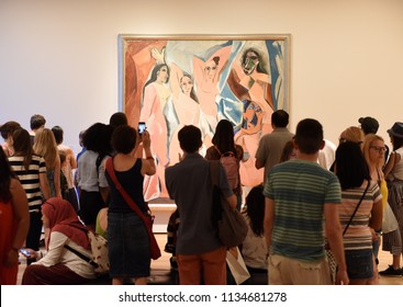 """New York, USA - May 25, 2018: Crowd of people near the Pablo Picasso painting """"Les Demoiselles D'Avignon"""" in Museum of Modern Art in New York City."""
