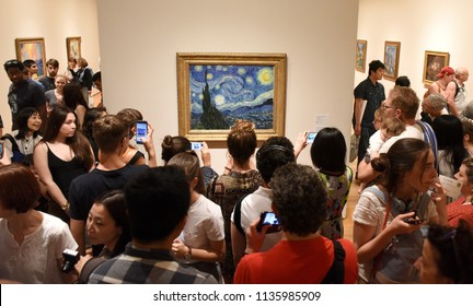 New York, USA - May 25, 2018: Crowd of people near the Starry Night by Vincent van Gogh painting in Museum of Modern Art in New York City.