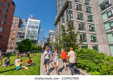 New York, USA - May 25, 2018: People walking along The High Line in New York. It is a elevated greenway on the west side of Manhattan in New York City.