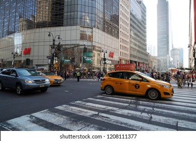 NEW YORK, USA - MAY 25 2018 - Times Square is a major commercial intersection, tourist destination, entertainment center and neighborhood in the Midtown Manhattan