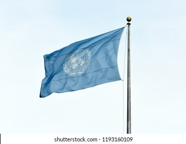 NEW YORK, USA - May 26, 2018: UN flag waving in the sky near the United Nations Building in New York.