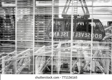 New York, USA - May 26, 2017: Roosevelt Island cable tramway car reflected in buildings windows. Aerial tram connects Roosevelt Island to the Upper East Side of Manhattan.