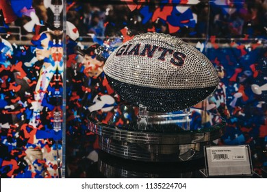 NEW YORK, USA - MAY 28, 2018: Swarovski Giants ball on sale in NFL Experience in Times Square, New York, a first-of-its-kind live action attraction, combining interactive games and 4D theatre.