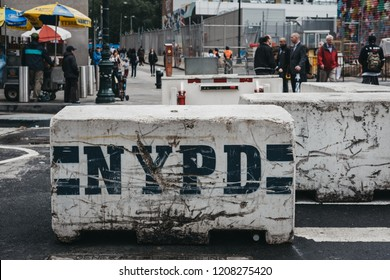 New York, USA - May 28, 2018: NYPD concrete barrier blocks deployed on the street in New York, USA. The blocks designed to prevent attacks and stop cars getting on the pavements.