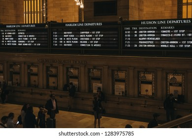 New York, USA - May 28, 2018: Train times and Harlem trains departure board inside Grand Central Terminal, a world-famous landmark and transportation hub in Midtown Manhattan, New York.