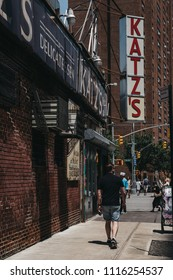 New York, USA - May 29, 2018: Man walks on Ludlow Street past Katz's Deli in New York, iconic kosher-style delicatessen that has been open since 1888.